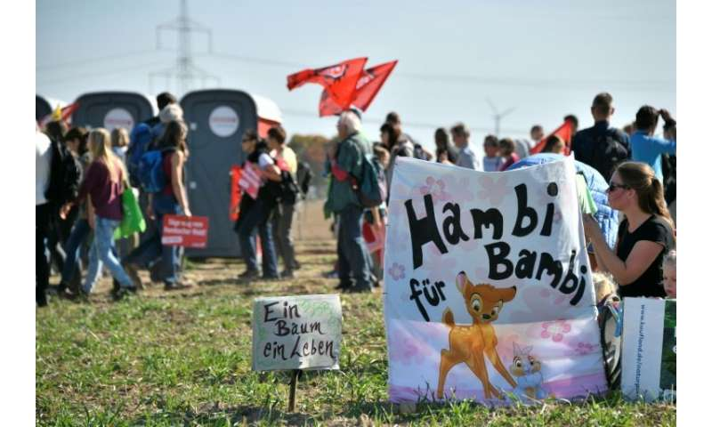 """A banner reads """"Hambi for Bambi"""" as thousands of demonstrators gather to celebrate the suspension of the planned razin"""