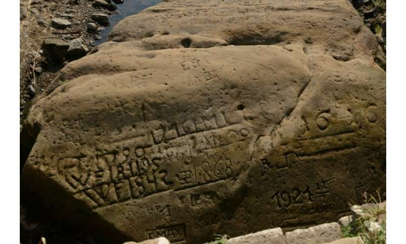 "About 20 such ""hunger stones"", engraved with markers and dates going back centuries, can still be found on the banks o"