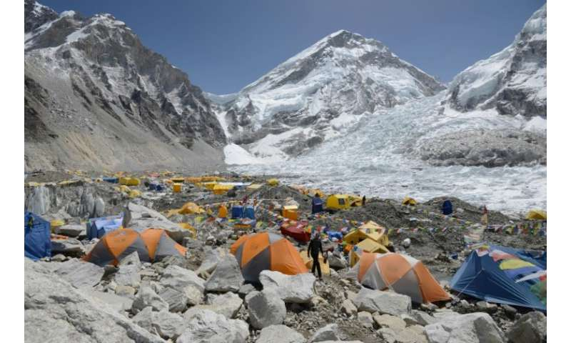 A climber walks through base camp below Everest, which is suffering from a dangerous shortage of its most important resource: ex