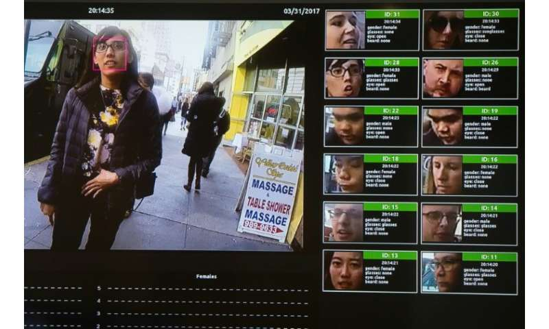 A display shows a facial recognition system for law enforcement during the NVIDIA GPU Technology Conference, which showcases art