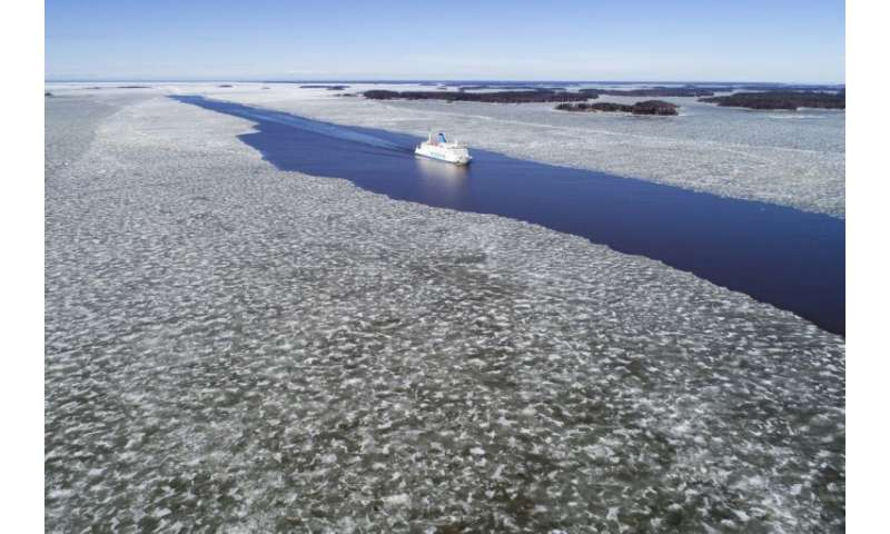 A ferry sails through the melting ice near Vaasa in western Finland
