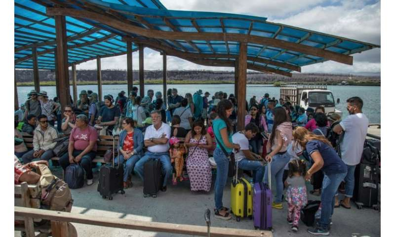 A group of tourists arrive on Santa Cruz Island after crossing the Itabaca channel in the Galapagos—by law, even Ecuadorans from
