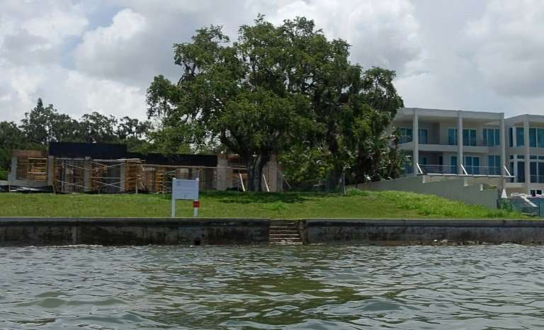 A home goes up on the shore in the Indian Beach neighborhood of Sarasota, Florida, a state which faces the highest risk of prope