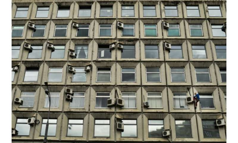 Air conditioners on a building in Moscow, part of a worldwide demand for cooling systems that is expected to tripple over the ne