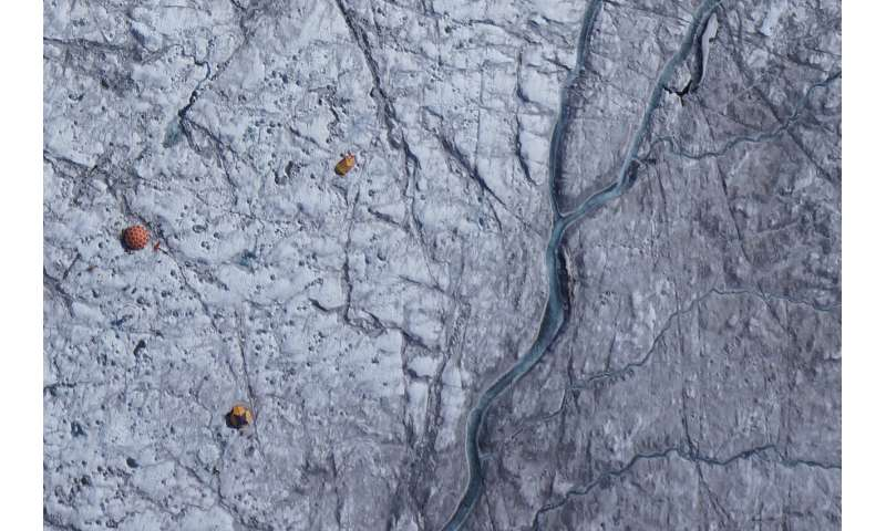 Algae, impurities darken the Greenland ice sheet and increase melting