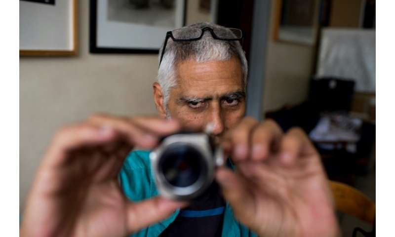 Although working with equipment and techniques that have virtually disappeared, he carries on as if digital photography does not