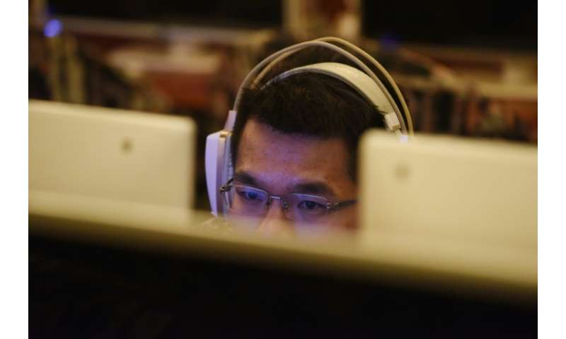 A man uses a computer in an internet cafe in Beijing: China is tightening controls by curbing the use of VPNs