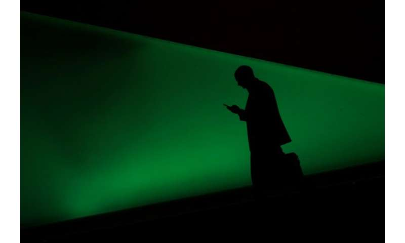 A man uses a smartphone on the first day of the Mobile World Congress in Barcelona