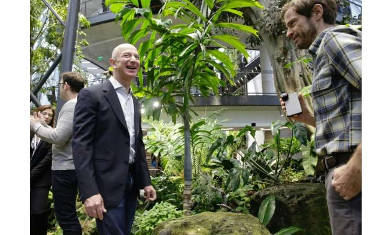Amazon CEO Jeff Bezos tours the facility at the grand opening of the Amazon Spheres rainforest-inspired offices in Seattle, Wash