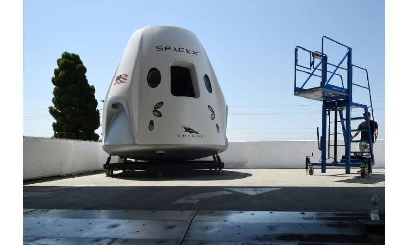 A mock up of the Crew Dragon spacecraft is displayed during a media tour of SpaceX headquarters and rocket factory in Hawthorne,
