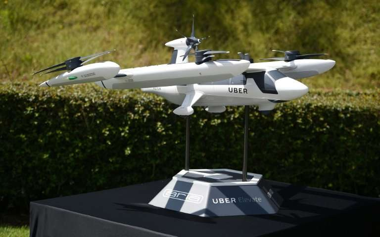 A model of Uber's electric vertical take-off  and  landing vehicle concept (eVTOL) flying taxi is displayed at the second annual