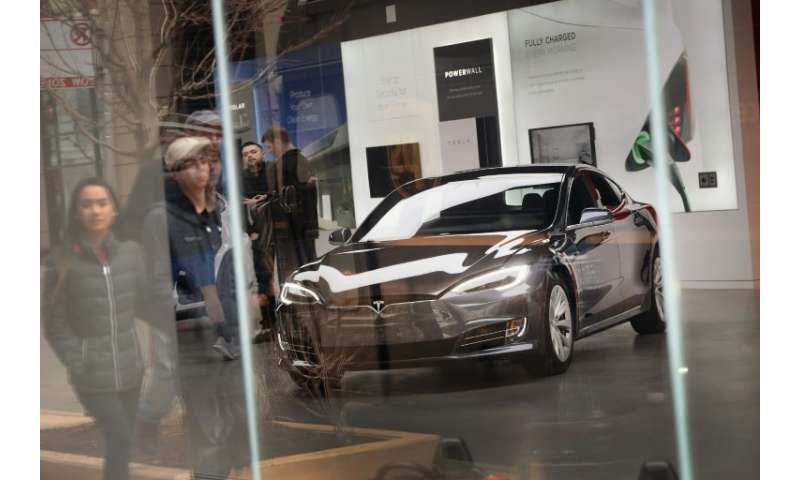 A Model S sits on the showroom floor at a Tesla dealership on March 30, 2018 in Chicago, Illinois