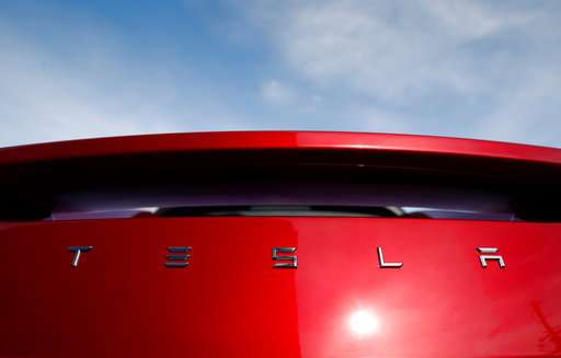 Analysts expect Tesla 2Q revenue gain but big net loss