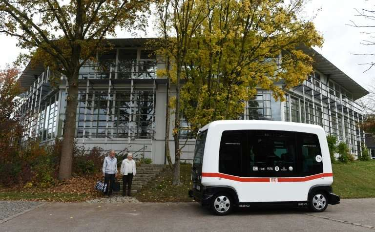 An autonomous bus drives during a presentation in southern Germany