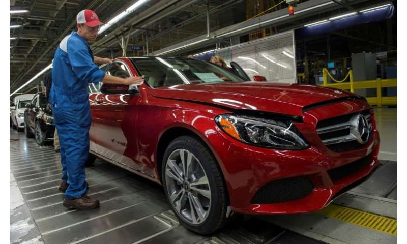 An employee conducting a final inspection on a Mercedes-Benz C-Class at the Mercedes-Benz US International factory in Vance, Ala