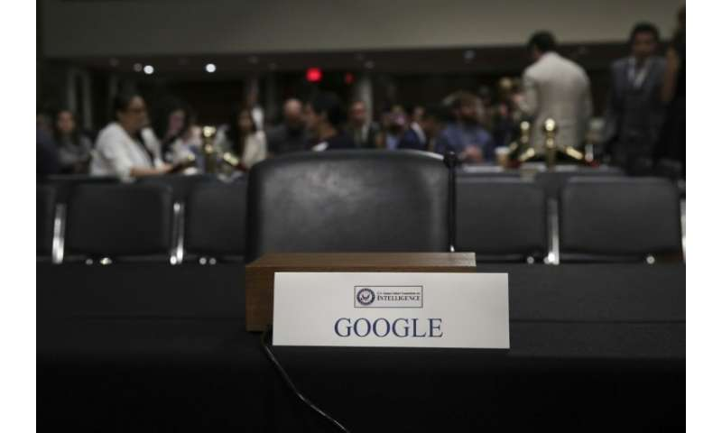 An empty seat for Google is seen during a Senate Intelligence Committee hearing concerning foreign influence operations' use of