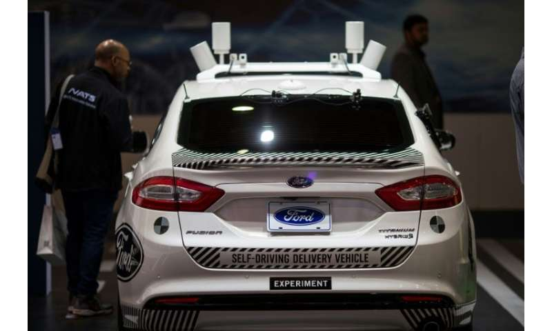 An experimental Ford Fusion self-driving delivery car is displayed shown at the Consumer Electronics Show in Las Vegas