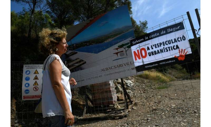 A poster against property speculation at a construction site in S'Antiga near the Platja de Pals or Beach of Pals on the Costa B