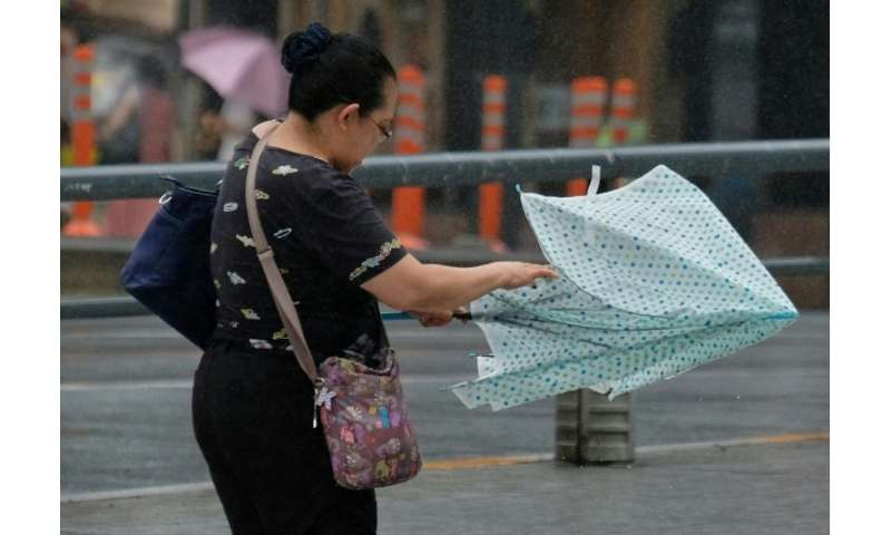 Authorities urged residents to stay on alert as the typhoon could still trigger landslides and flooding