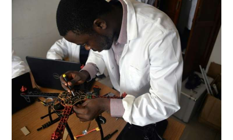 A young engineer works on making a drone entirely built in Cameroon at the Will & Brothers company premises in Douala