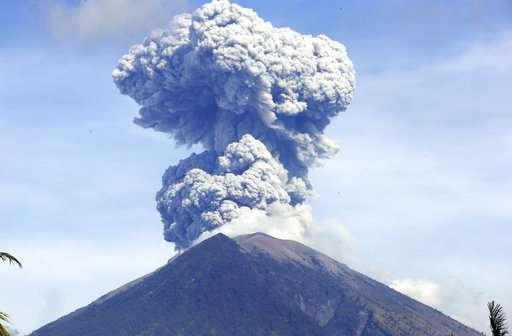 Bali volcano hurls lava and ash, airport unaffected