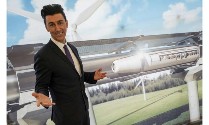 Bibop Gresta (pictured in front of a rendering of a hyperloop project) plans to build a 10-kilometre test track in southwest Chi