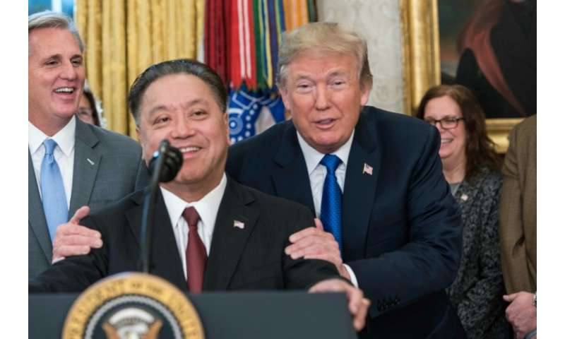 Broadcom CEO Hock Tan is seen at a November 6 White House meeting with President Donald Trump, at which Tan announced plans to m