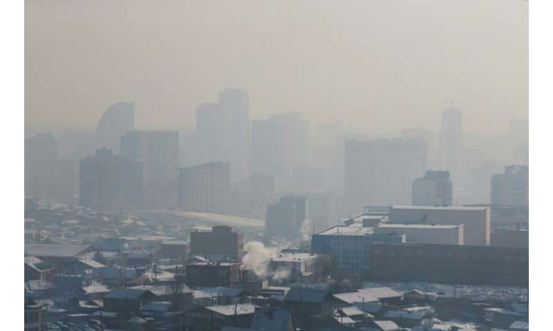 Buildings disappear in the smog in Ulaanbaatar, where residents have resorted to sipping 'lung' tea and 'oxygen cocktails' in a