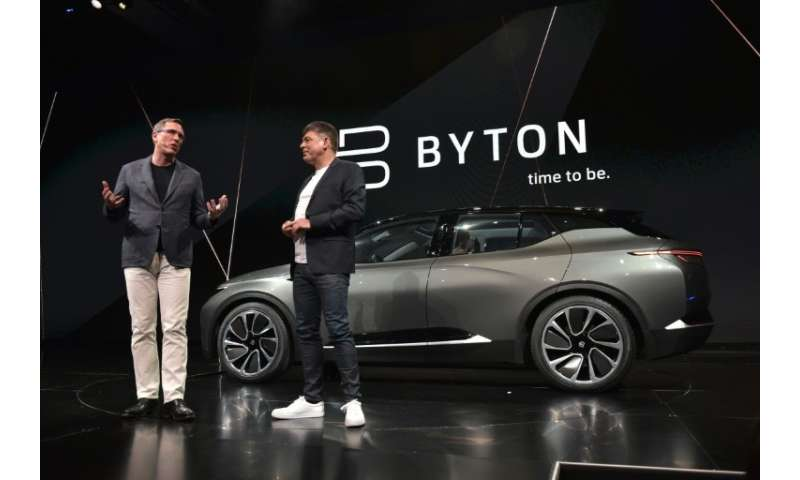 Byton president Daniel Kirchert, left, and CEO Carsten Breitfeld show the Byton connected car during CES 2018 in Las Vegas