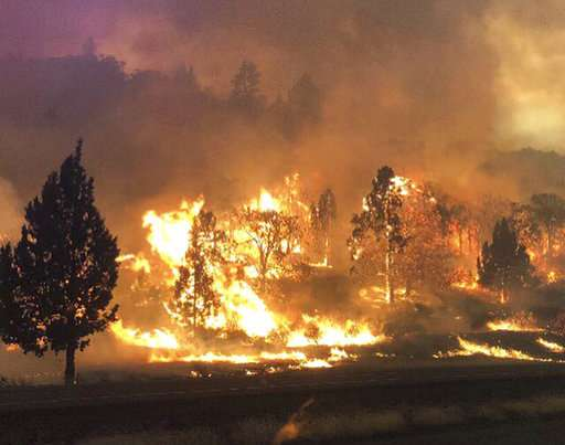California fire kills 1 as heat stokes blazes in Western US