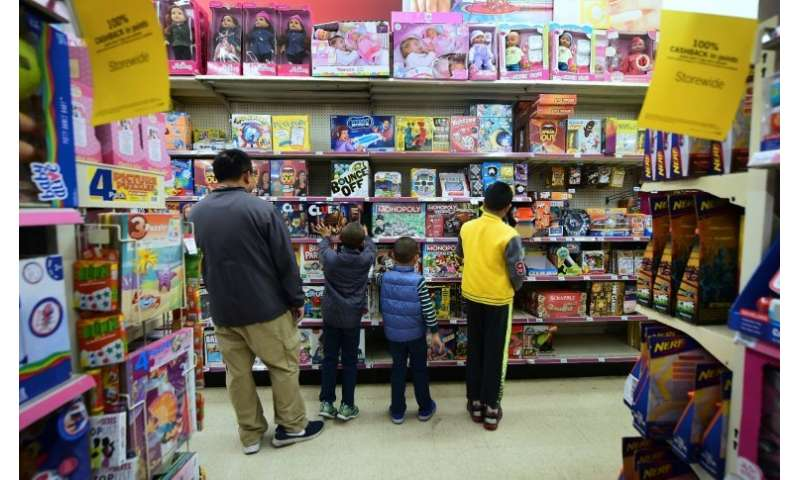 Children view board games at a Kmart store open early with Black Friday sales on Thanksgiving Day in Rosemead, California on Nov