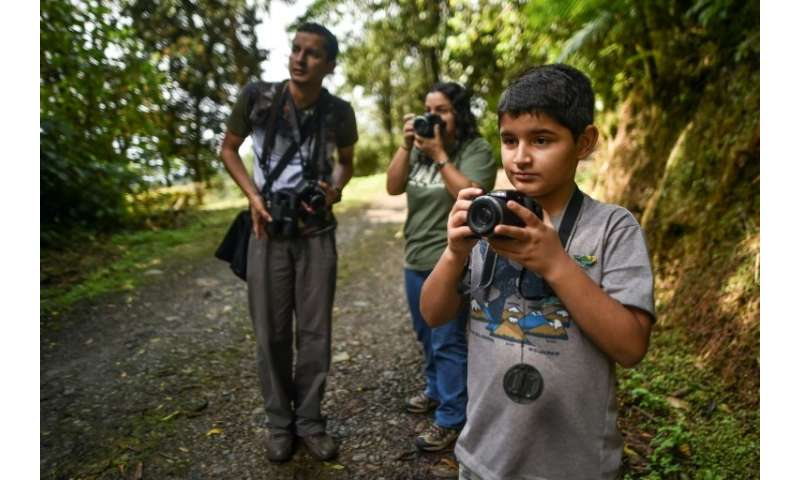 Colombian birdwatcher Juan David Camacho), 10, aims to see all the birds his country has to offer