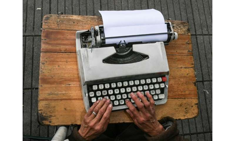 Colombia's street clerks work in the open air on with their typewriters perched on a tiny table in front of them