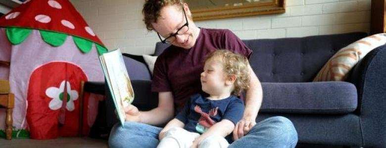 Dad's reading is new chapter of child language development