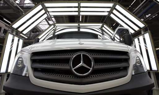 Daimler earnings hit by trade tensions, emissions rules