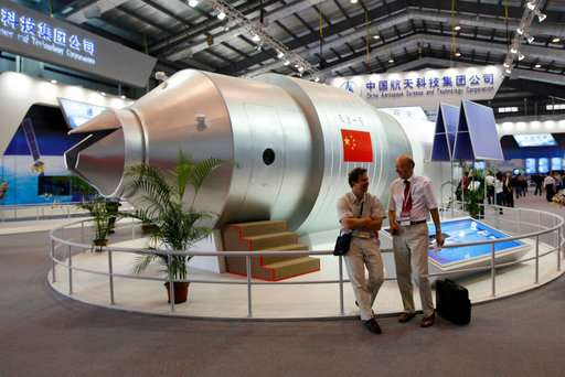 Defunct Chinese space lab hurtles toward Earth on wide path