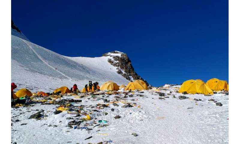 Discarded climbing equipment and rubbish scattered around Camp 4 of Mount Everest, where decades of commercial mountaineering ha
