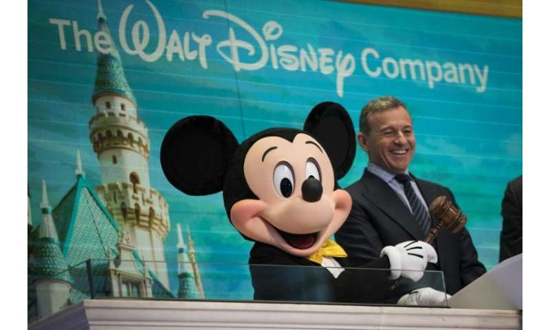 Disney CEO chief Bob Iger—shown here with Mickey Mouse preparing to ring the opening bell at the New York Stock Exchange in Nove
