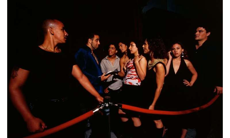 Do bouncers at clubs enforce dress codes equally across races?