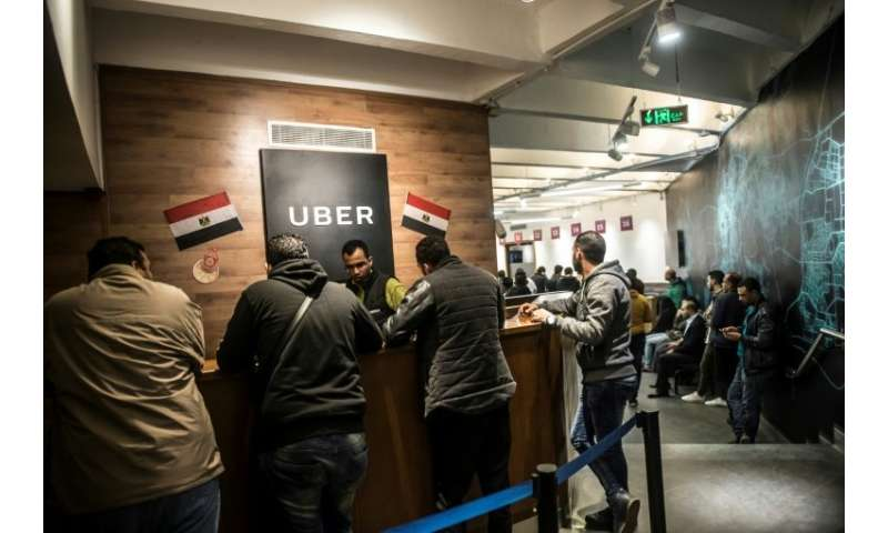 Drivers working for Uber meet at the company's Egyptian headquarters in Cairo