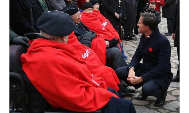 Dutch Prime Minister Mark Rutte is seen here greeting veterans after laying a wreath at the National War Memorial in Ottawa, Ont