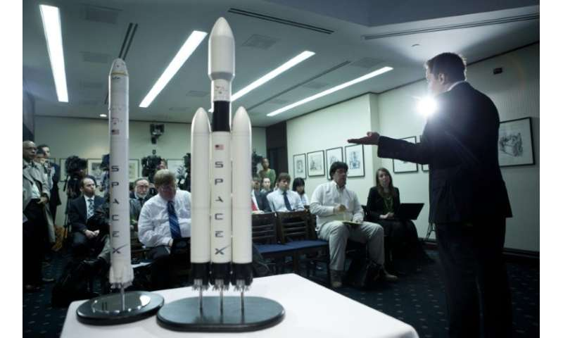 Elon Musk, CEO of Space X, shows off a mockup of the Falcon Heavy rocket, which is finally ready for its first launch