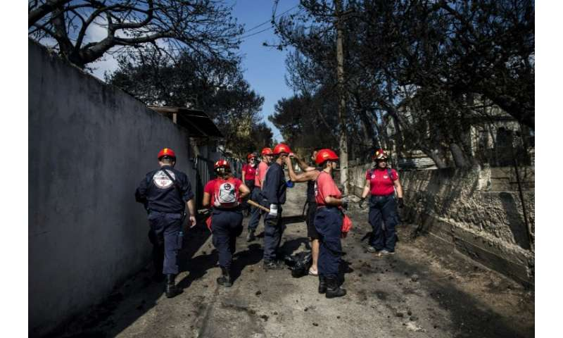 Emergency crews were searching incinerated homes and vehicles in the village of Mati, near Athens