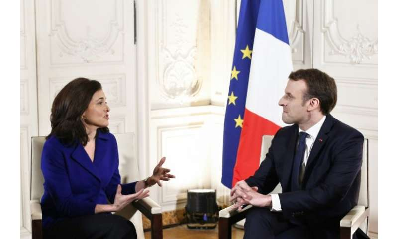 Facebook's Sheryl Sandberg, seen at a January 2018 meeting with French President Emmanuel Macron, has been known for bringing po