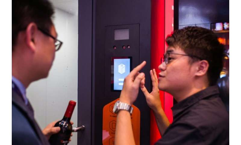 Facial recognition allows customers into an adjoining payment room where sensors recognise which bottles they are carrying