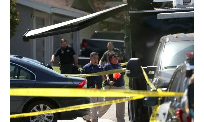 FBI investigators and sheriff's deputies are seen at DeAngelo's Citrus Heights, California, home