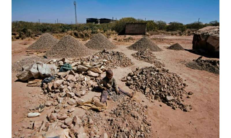 File picture of a child breaking rocks to extract cobalt at a quarry in Lubumbashi—in a 2016 report, Amnesty International said