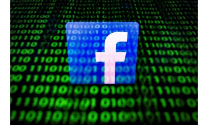 (FILES) In this file photo taken on April 26, 2018 in Paris shows the logo of social network Facebook displayed on a screen and