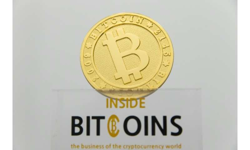 (FILES) This picture taken on January 17, 2018 shows a visual representation of the digital cryptocurrency Bitcoin, at La Maison