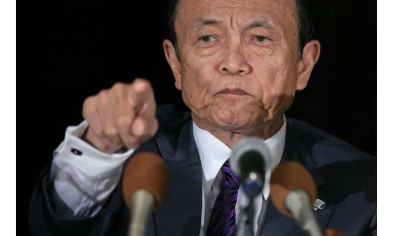"""Finance Minister Taro Aso said the raids were being carried out on exchanges to """"examine their internal governance structur"""